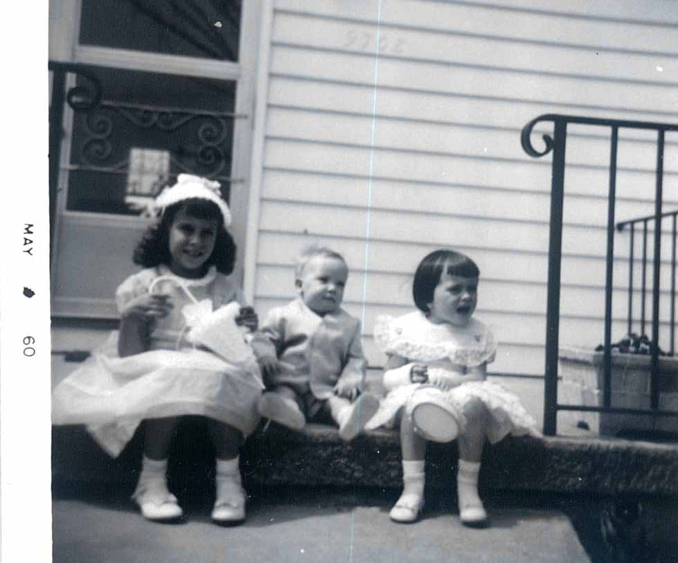 Photo of Linda, Mikey and Joann sitting on the step